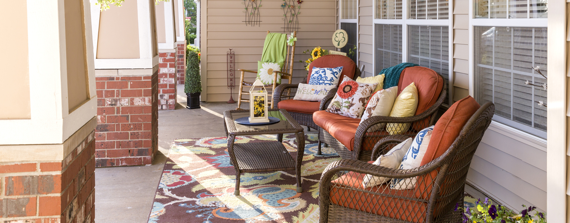 Relax in your favorite chair on the porch at Bickford of Omaha - Hickory