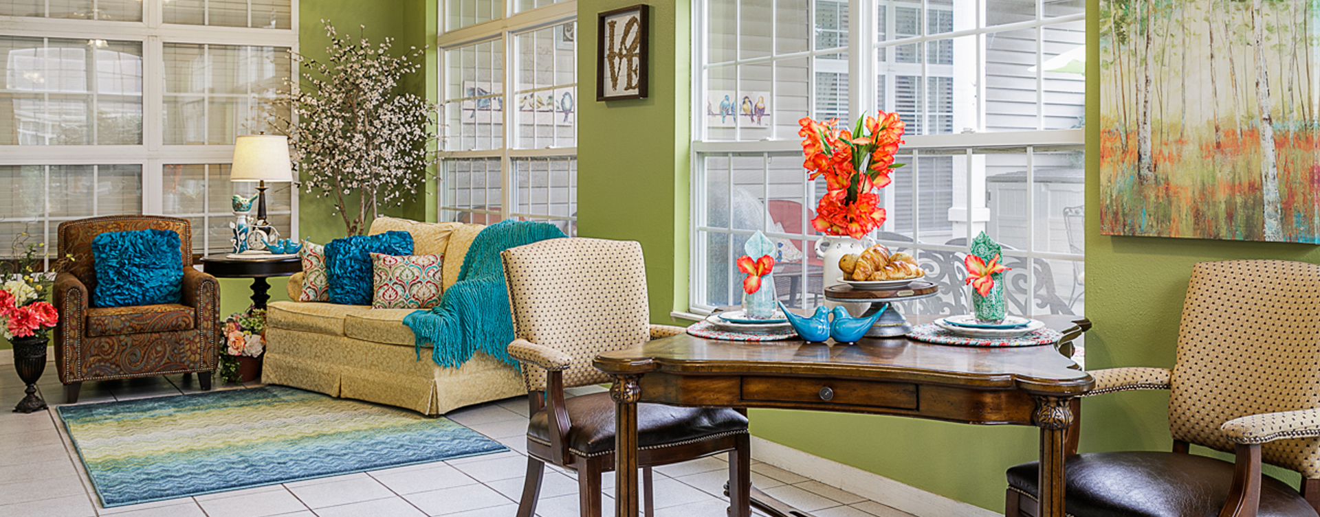 Relax in the warmth of the sunroom at Bickford of Omaha - Hickory