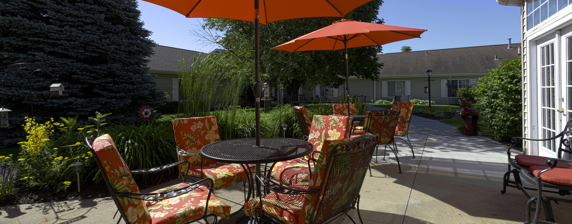 Enjoy the outdoors in a whole new light by stepping into our secure courtyard at Bickford of Omaha - Hickory