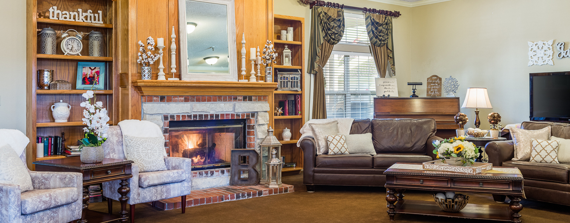 Enjoy a good book in the living room at Bickford of Ames