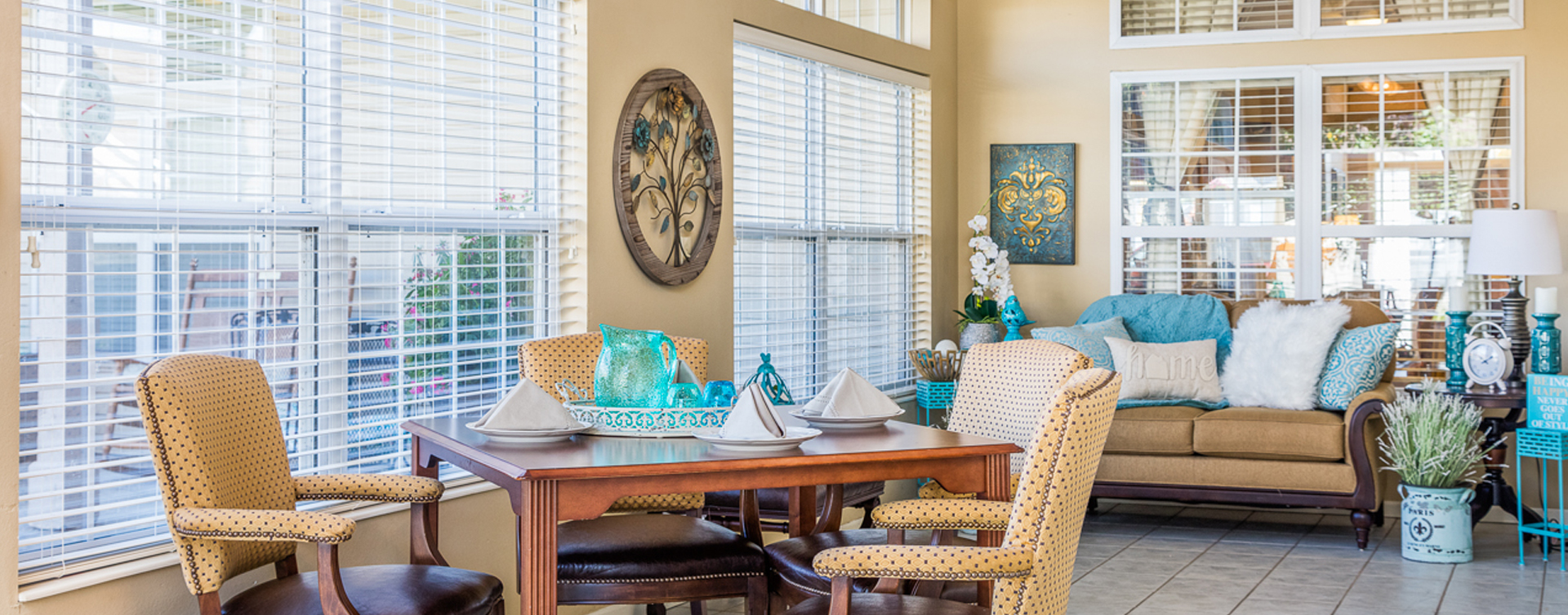 Enjoy the view of the outdoors from the sunroom at Bickford of Ames