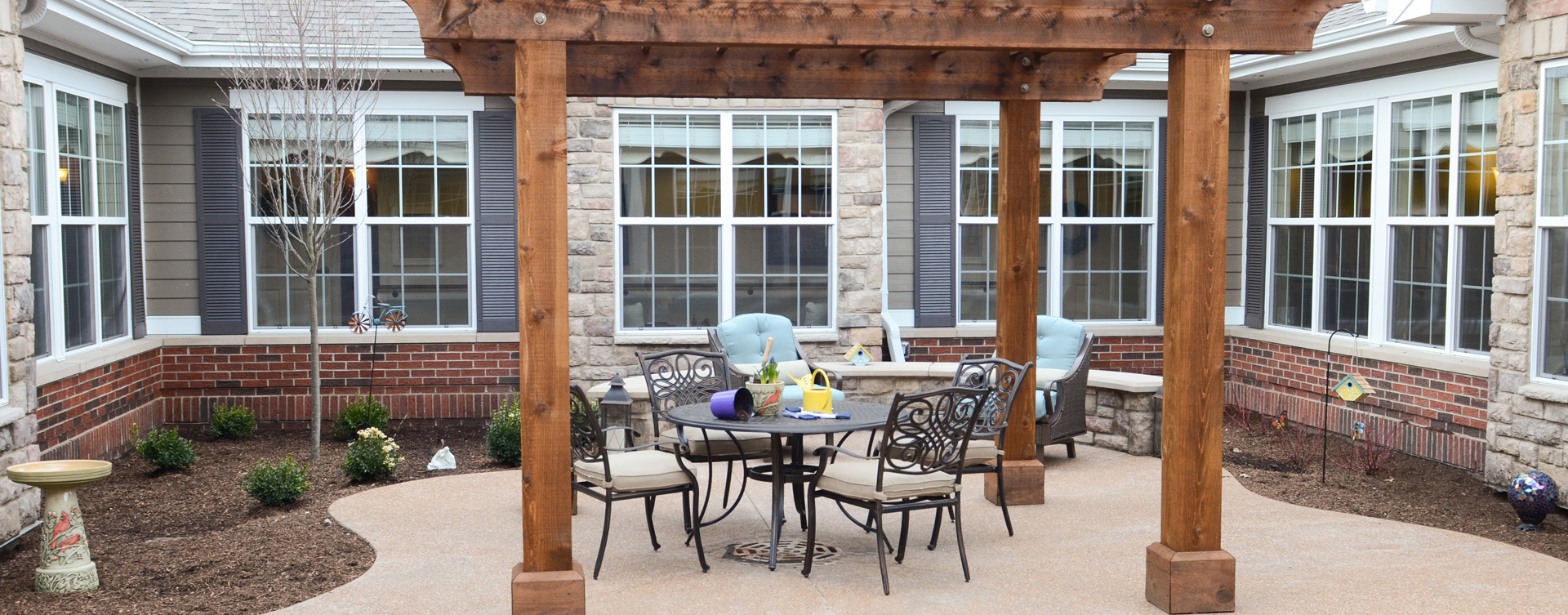 Residents with dementia can enjoy a traveling path, relaxed seating and raised garden beds in the courtyard at Bickford of Aurora