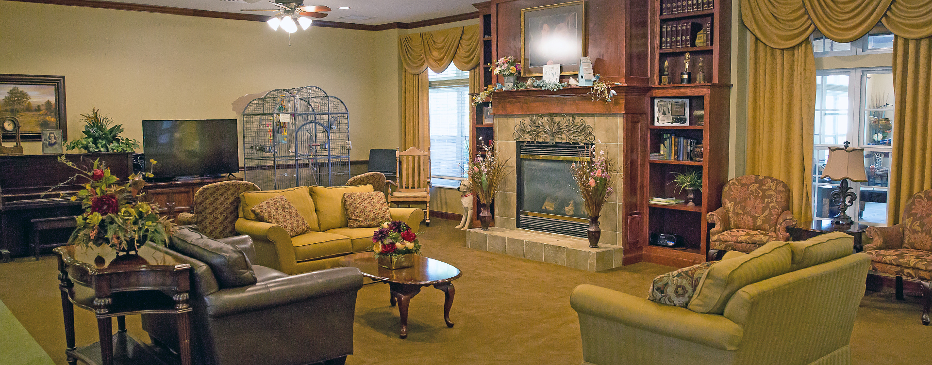 Enjoy a good book in the living room at Bickford of Battle Creek