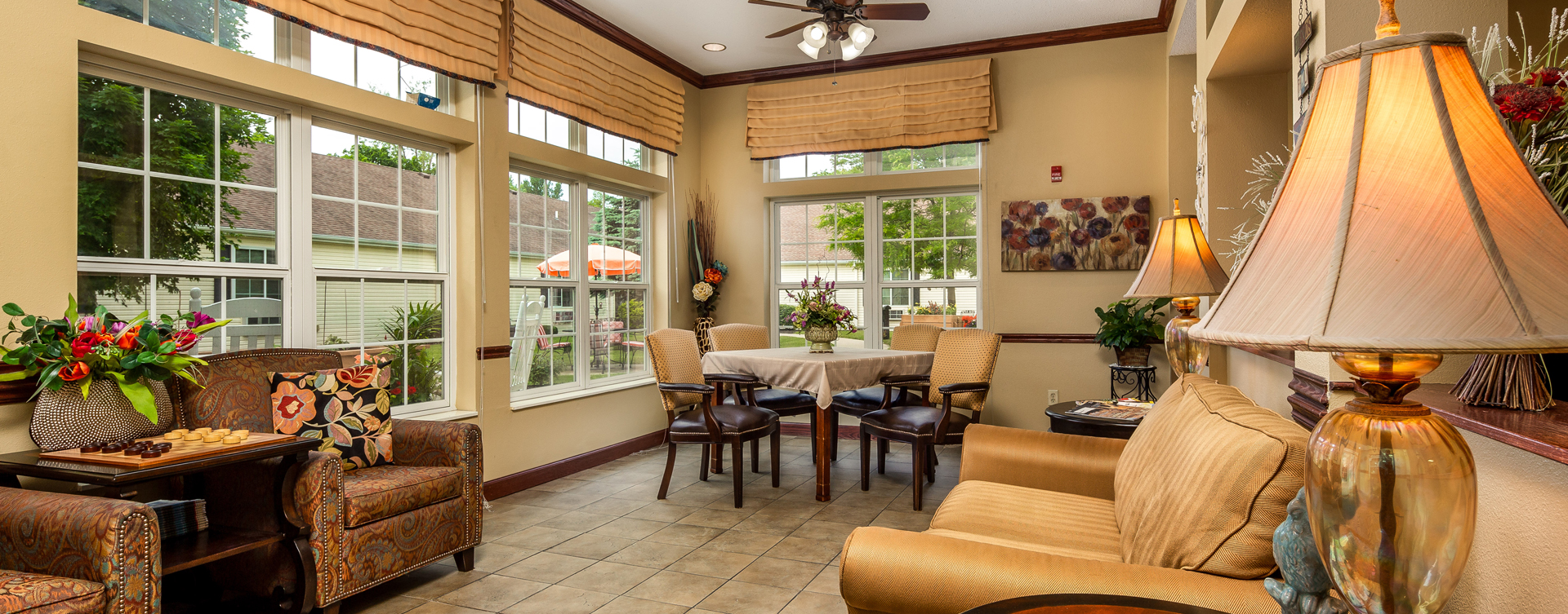 Enjoy the view of the outdoors from the sunroom at Bickford of Battle Creek