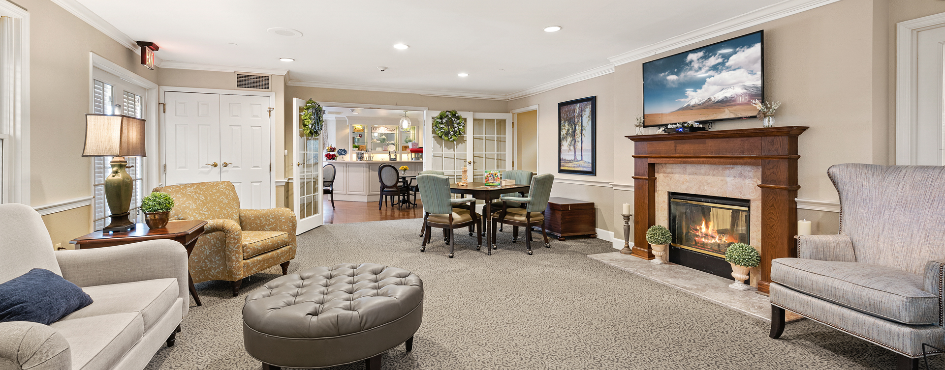 Socialize with friends in the living room at Bickford of Bexley