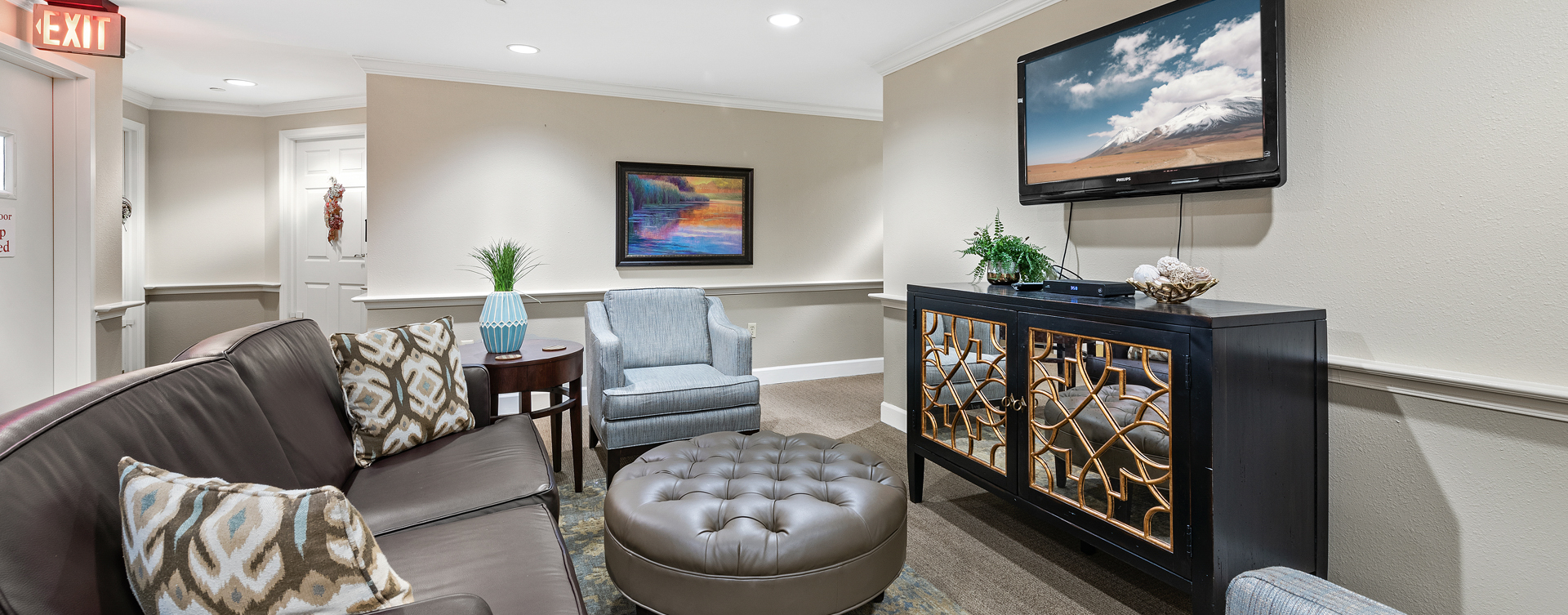 Residents can enjoy furniture covered in cozy fabrics in the Mary B's living room at Bickford of Bexley