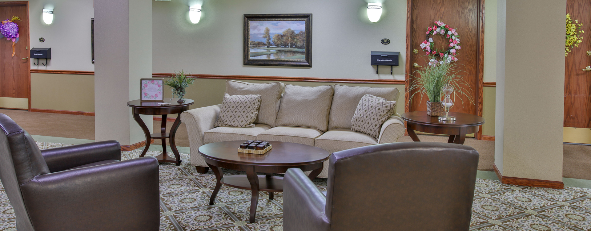 Socialize with friends in the living room at Bickford of Bloomington