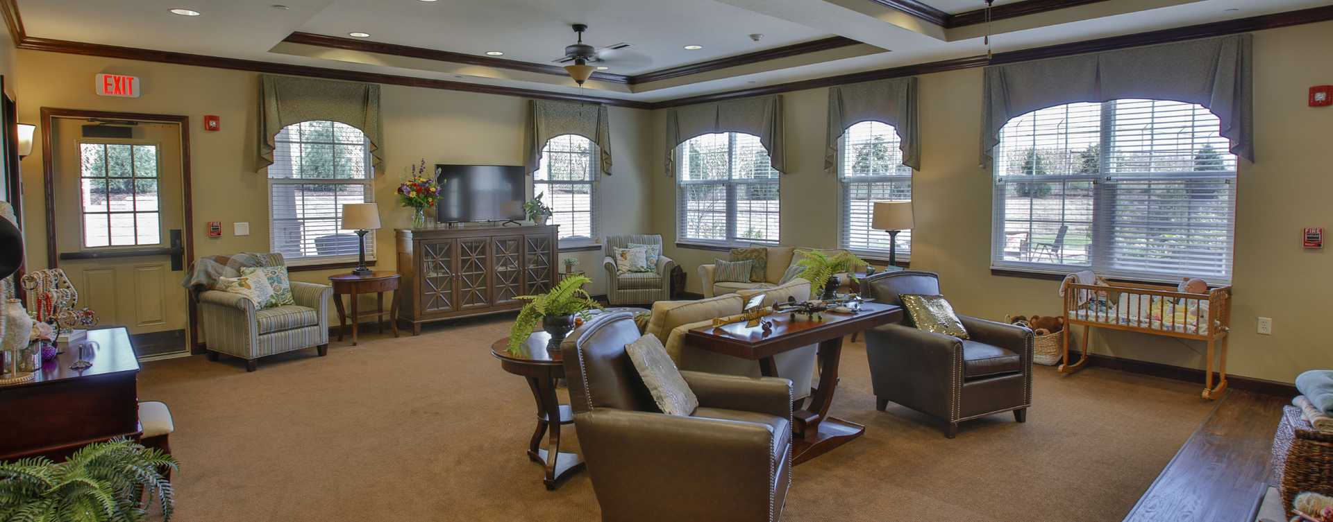 Chairs and sofas sit higher and are easier to get in and out of in the Mary B's living room at Bickford of Bloomington