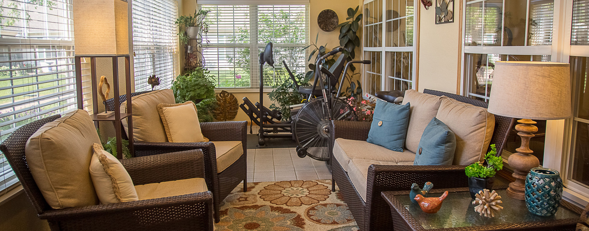 Enjoy the view of the outdoors from the sunroom at Bickford of Burlington