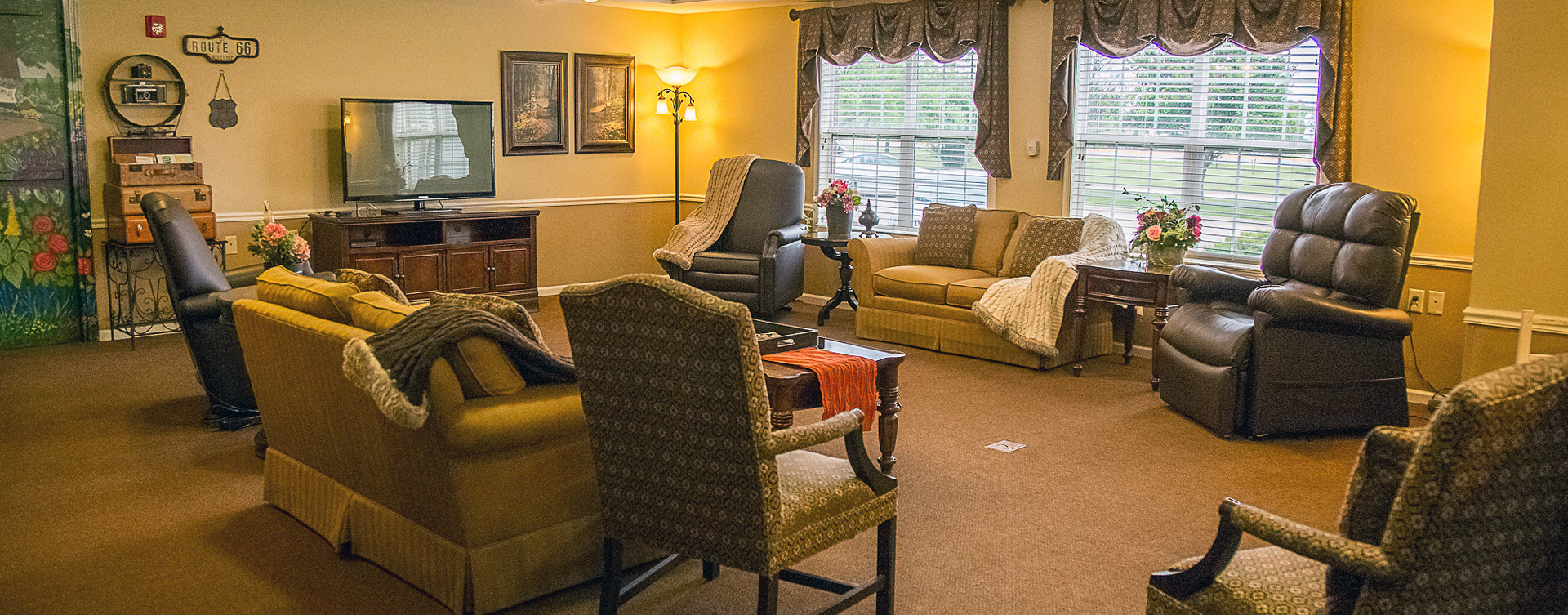 Residents can enjoy furniture covered in cozy fabrics in the Mary B's living room at Bickford of Burlington