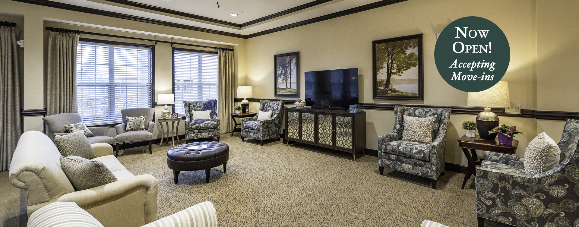Socialize with friends in the living room at Bickford of Canton