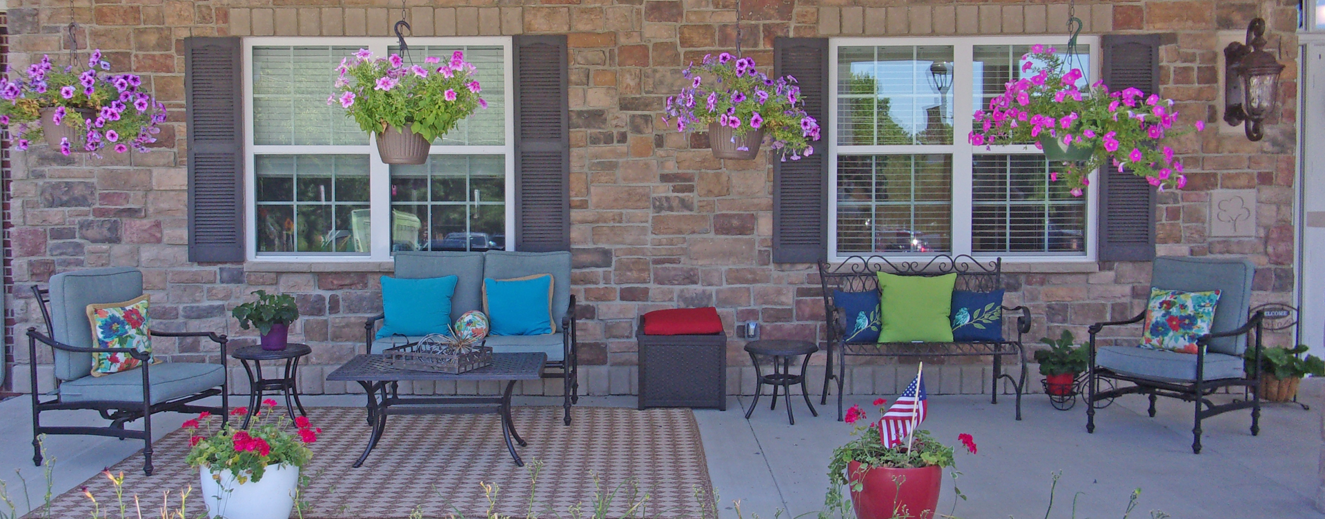 Enjoy conversations with friends on the porch at Bickford of Chesterfield