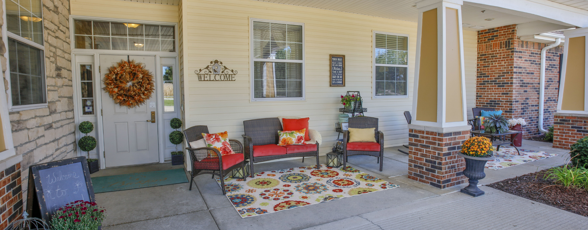 Enjoy conversations with friends on the porch at Bickford of Champaign
