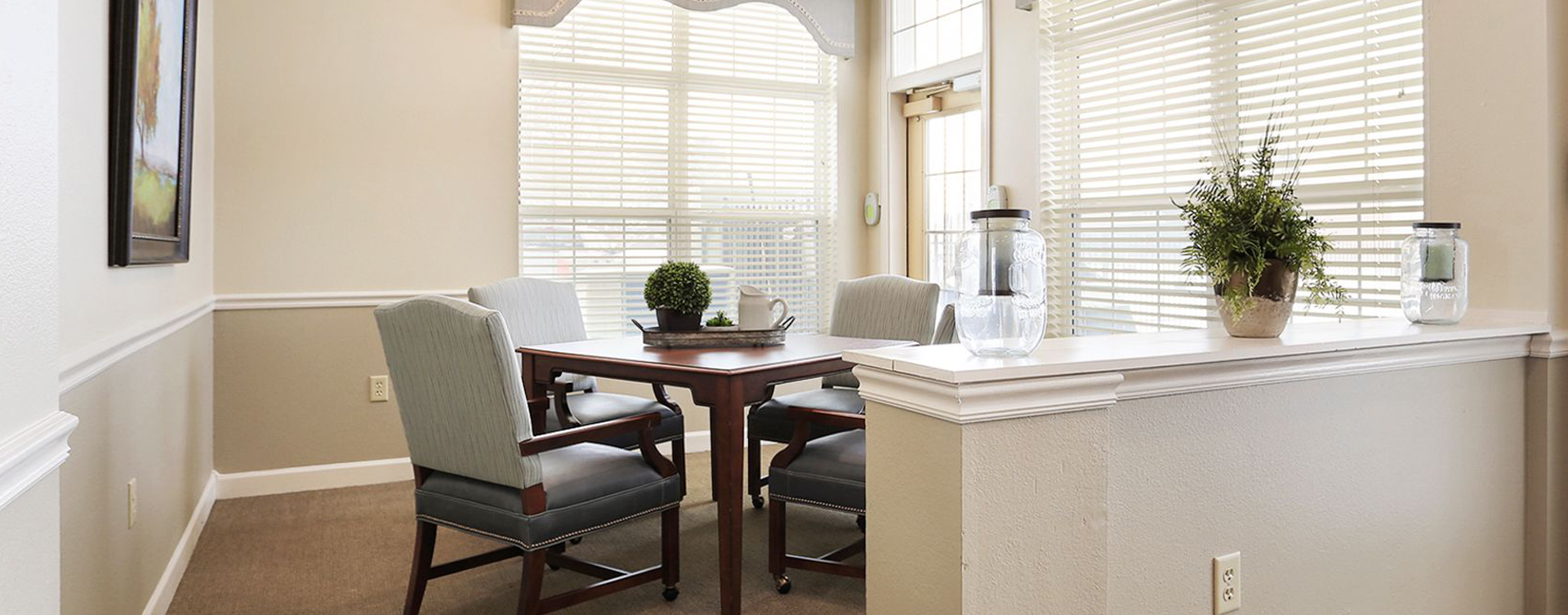 Relax in the warmth of the sunroom at Bickford of Champaign
