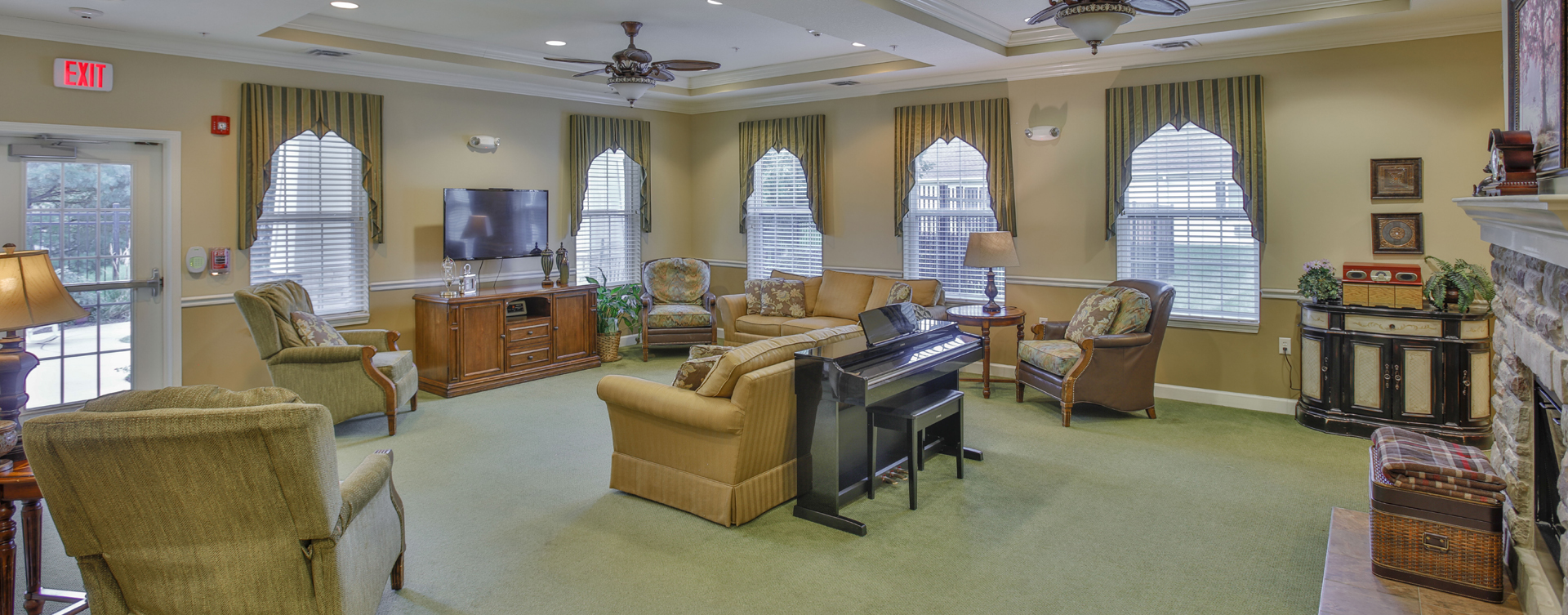 Chairs and sofas sit higher and are easier to get in and out of in the Mary B's living room at Bickford of Champaign