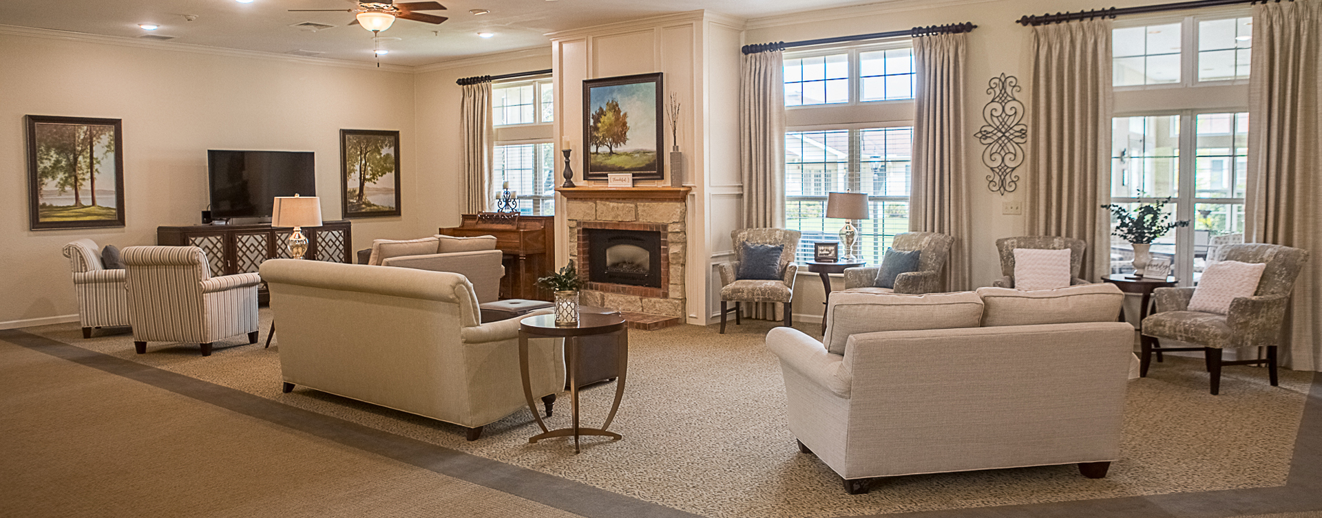 Socialize with friends in the living room at Bickford of Clinton