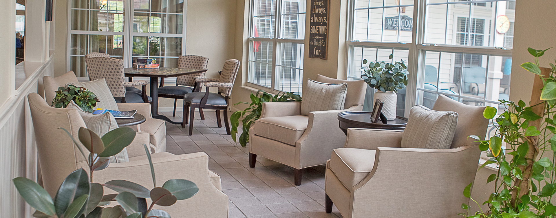 Enjoy the view of the outdoors from the sunroom at Bickford of Clinton