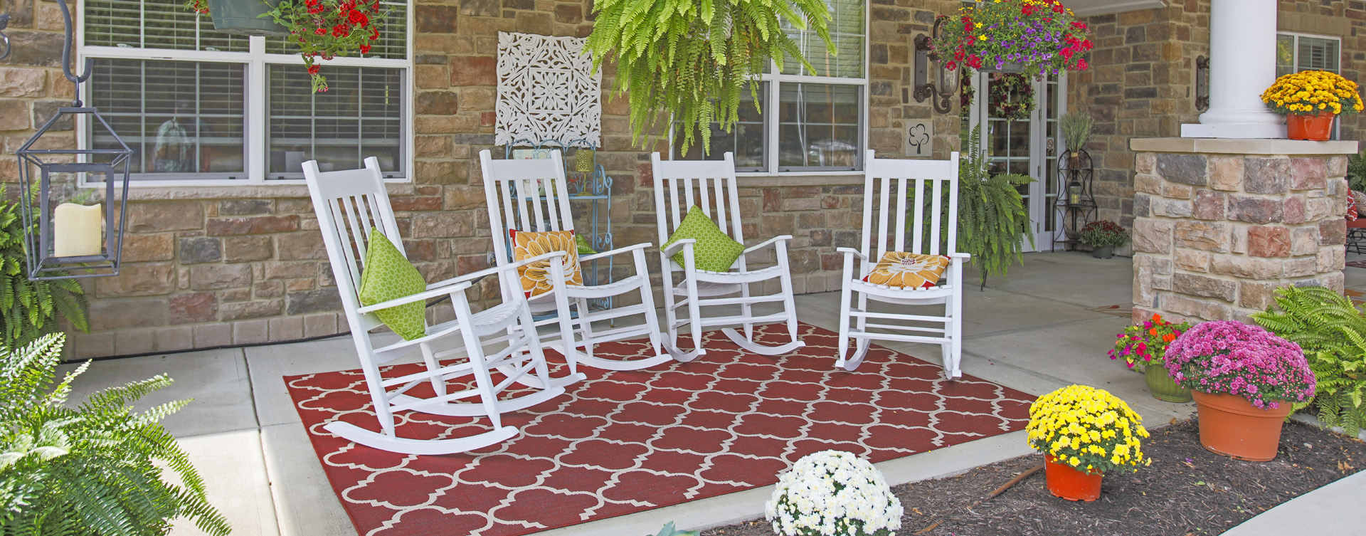 Enjoy conversations with friends on the porch at Bickford of Carmel