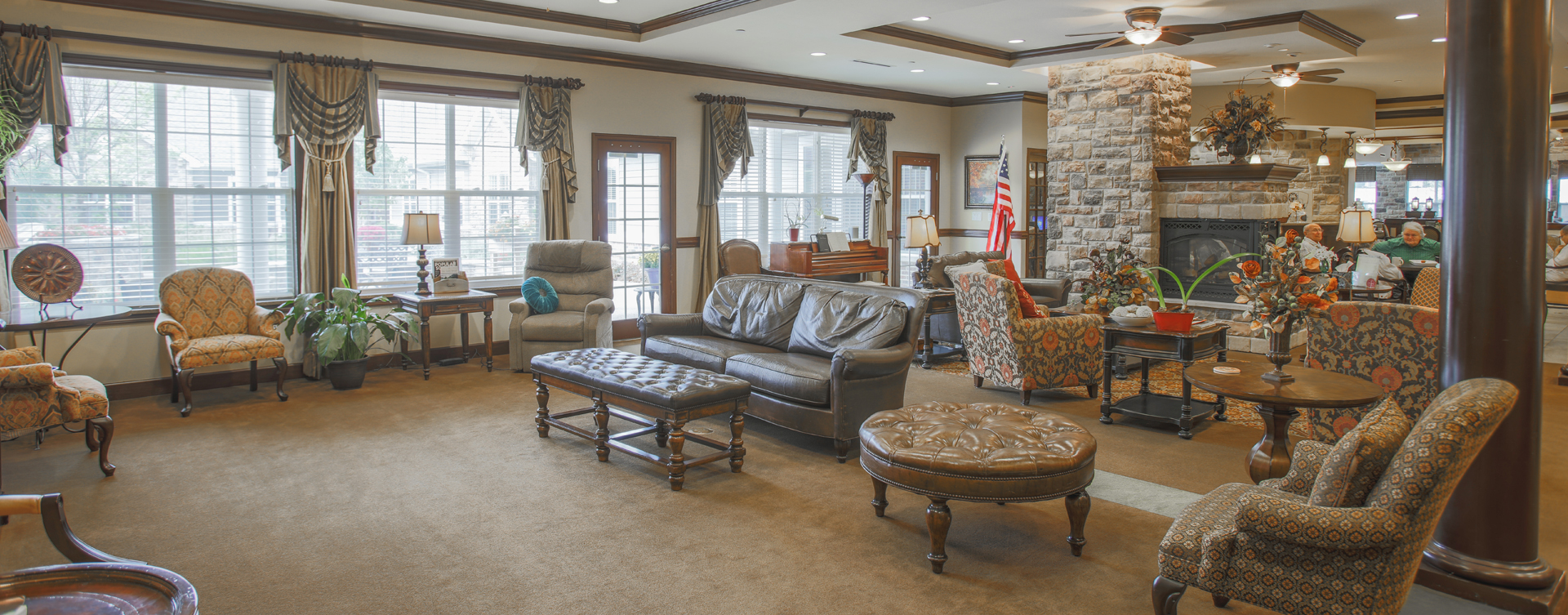 Socialize with friends in the living room at Bickford of Carmel