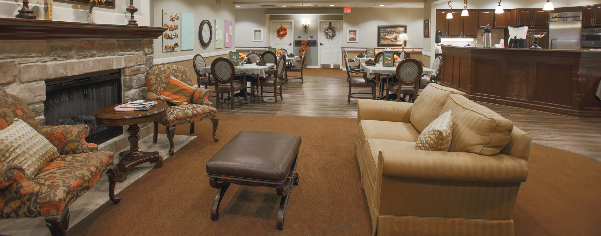 Chairs and sofas sit higher and are easier to get in and out of in the Mary B's living room at Bickford of Carmel