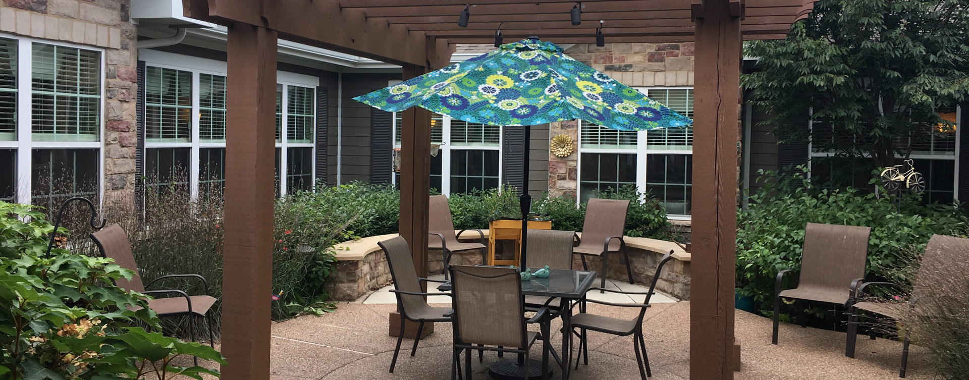 Residents with dementia can enjoy a traveling path, relaxed seating and raised garden beds in the courtyard at Bickford of Crown Point
