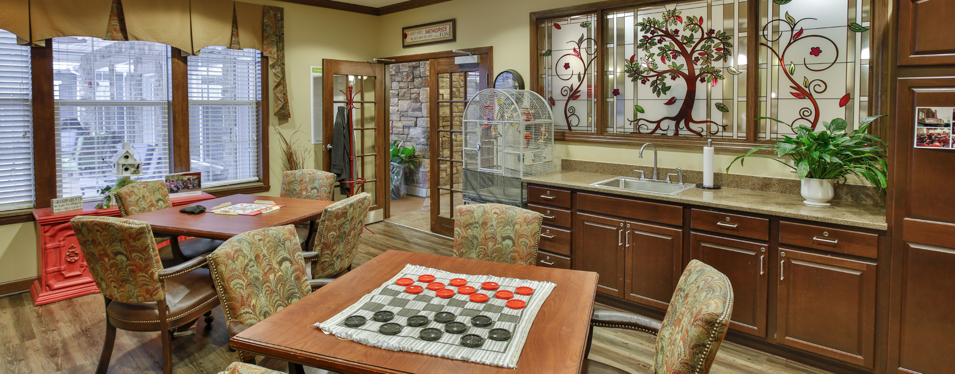 Enjoy a good card game with friends in the activity room at Bickford of Crown Point