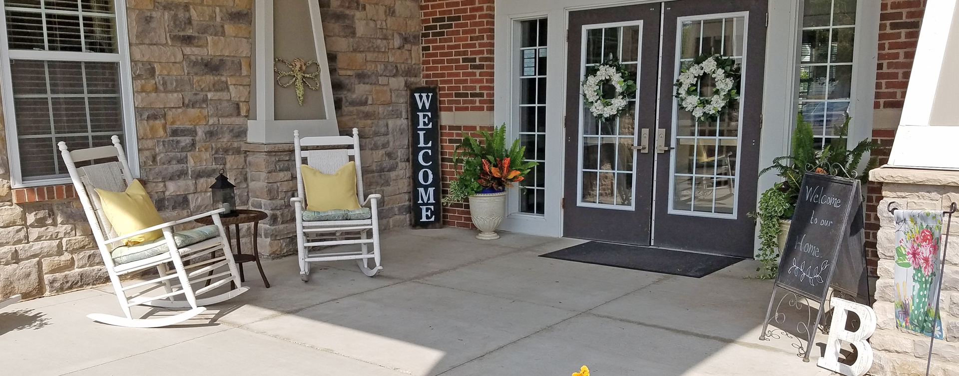 Relax in your favorite chair on the porch at Bickford of Crystal Lake