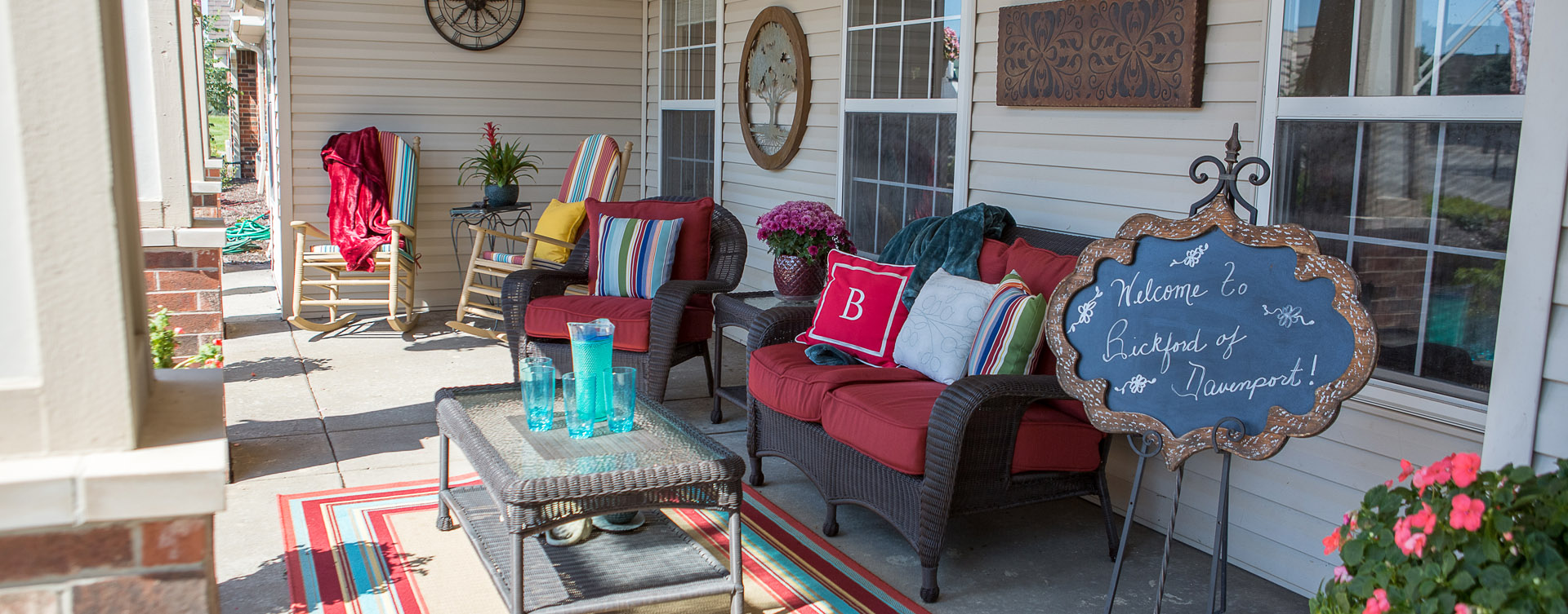 Enjoy conversations with friends on the porch at Bickford of Davenport