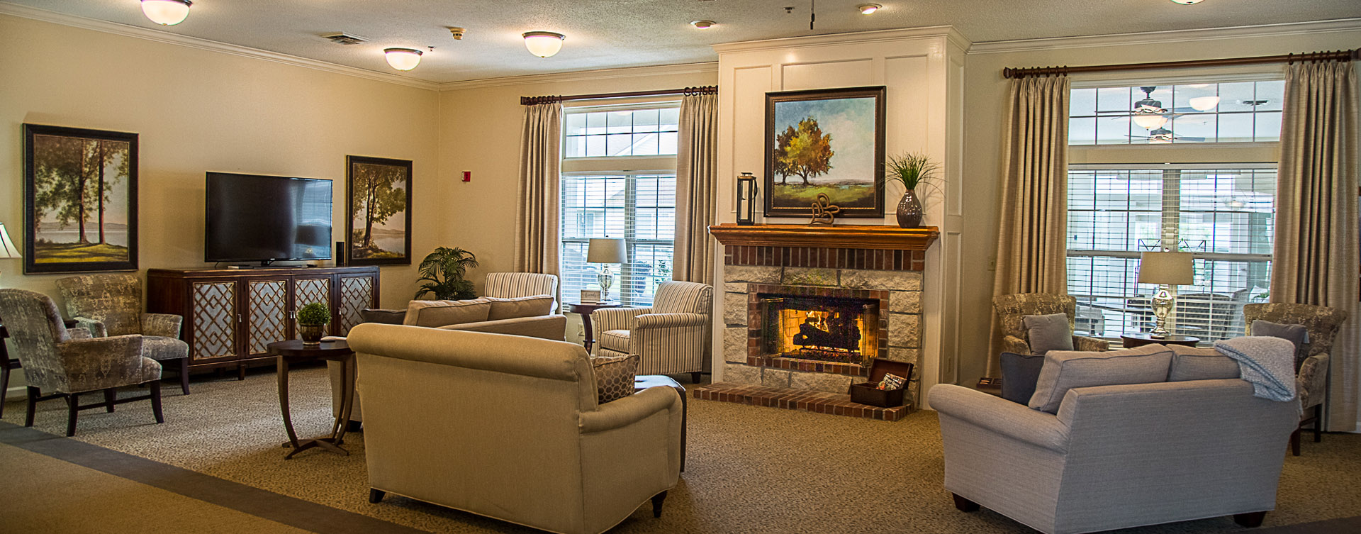 Socialize with friends in the living room at Bickford of Davenport