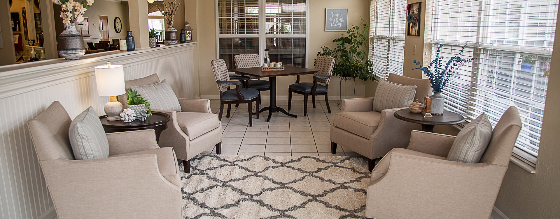 Relax in the warmth of the sunroom at Bickford of Davenport