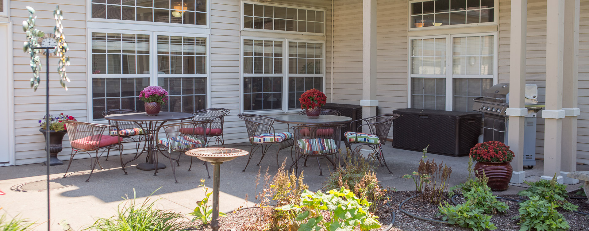 Enjoy bird watching, gardening and barbecuing in our courtyard at Bickford of Davenport