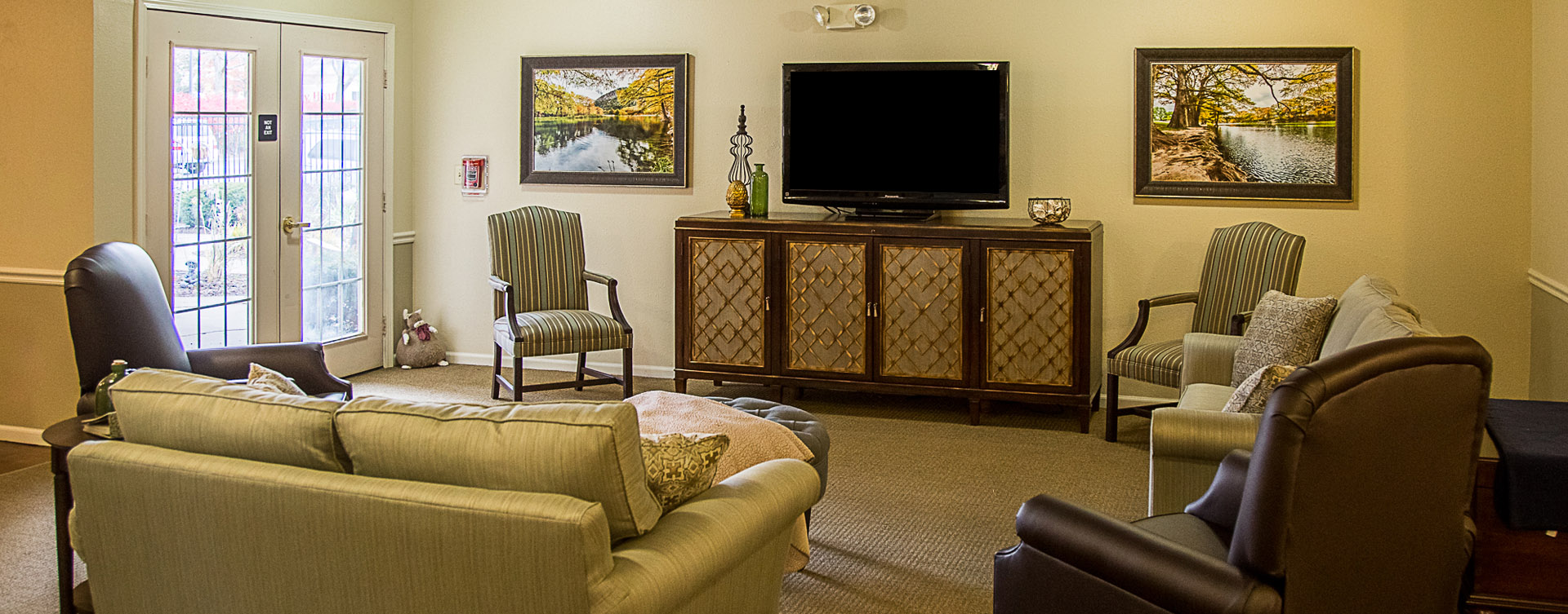 Chairs and sofas sit higher and are easier to get in and out of in the Mary B's living room at Bickford of Davenport