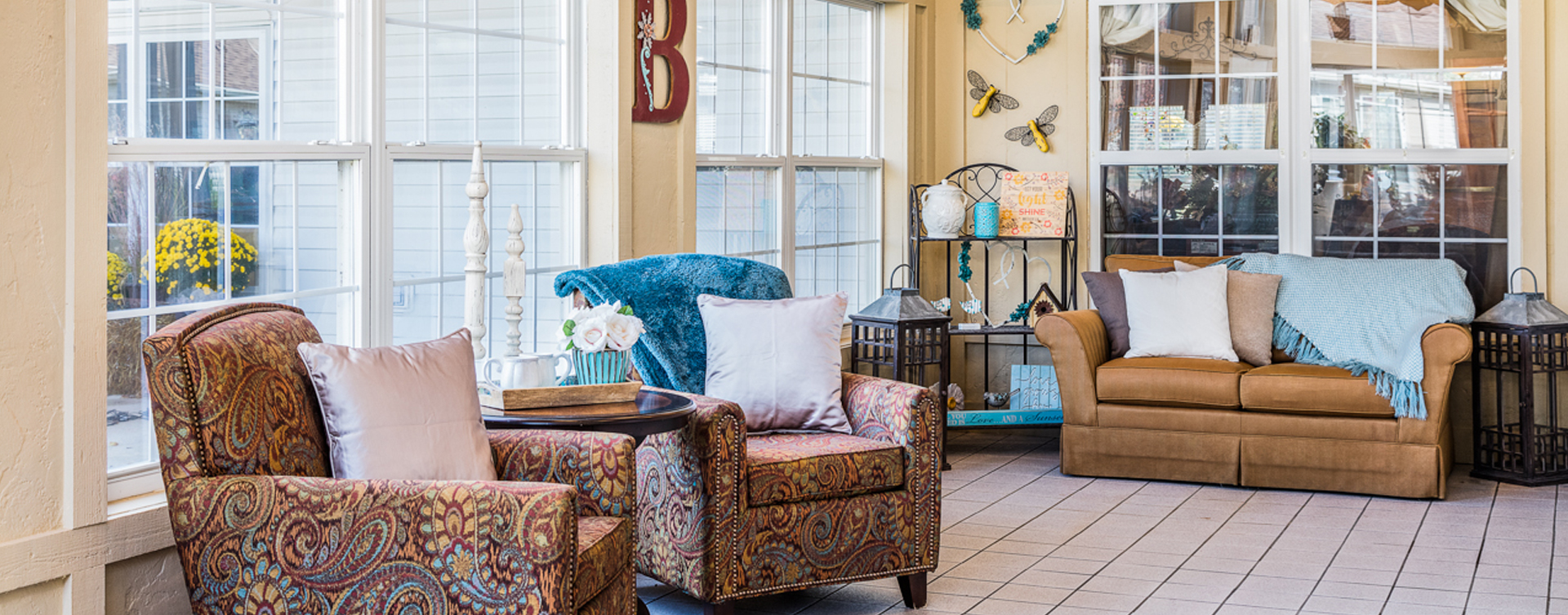 Relax in the warmth of the sunroom at Bickford of Fort Dodge