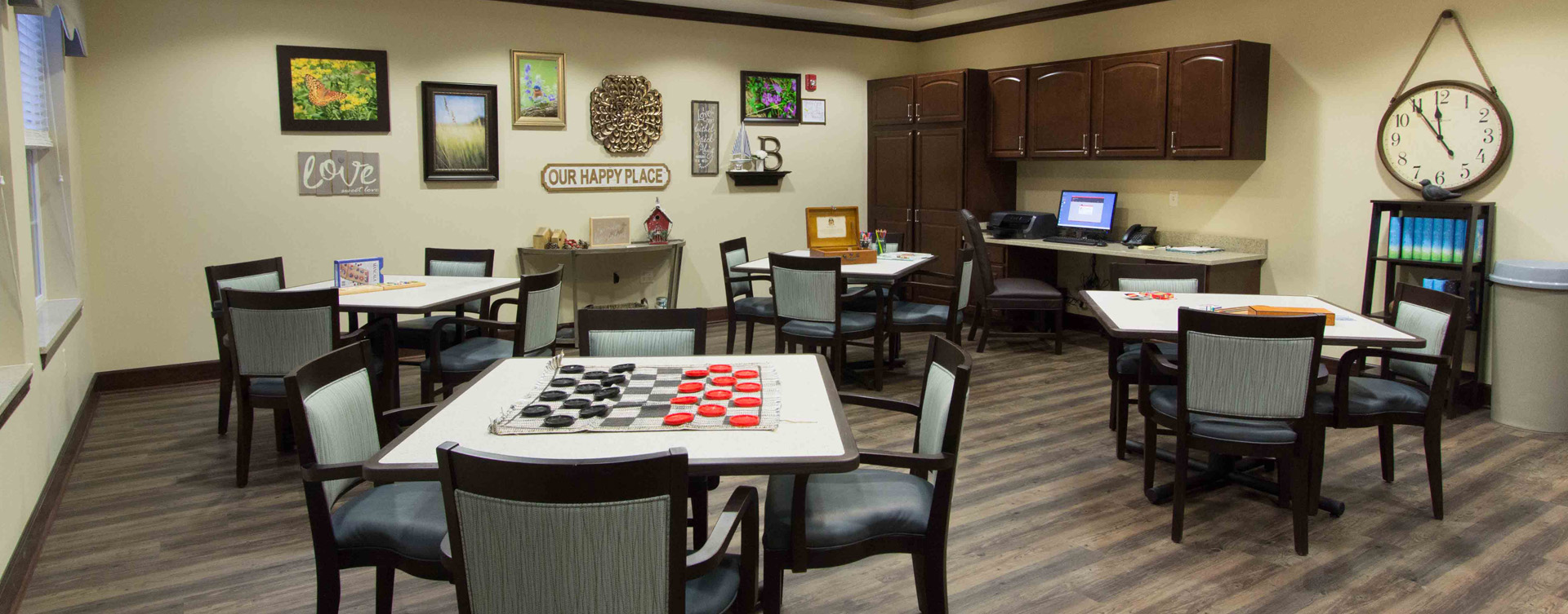 Enjoy a good card game with friends in the activity room at Bickford of Gurnee