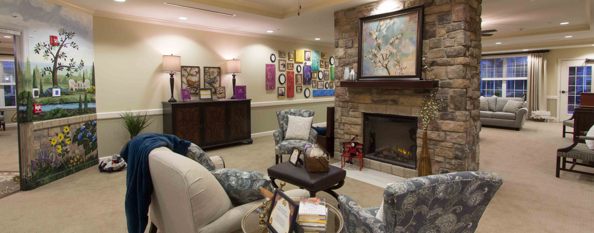 Residents can enjoy furniture covered in cozy fabrics in the Mary B's living room at Bickford of Gurnee