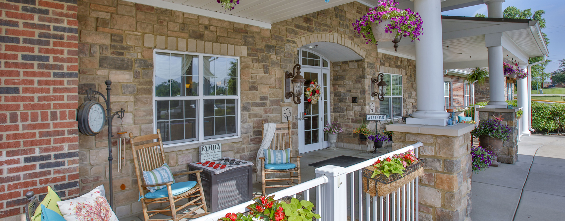 Enjoy conversations with friends on the porch at Bickford of Greenwood
