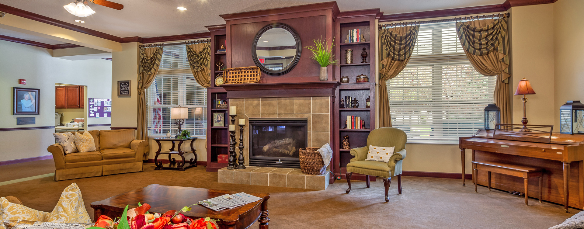 Snooze in your favorite chair in the living room at Bickford of Okemos