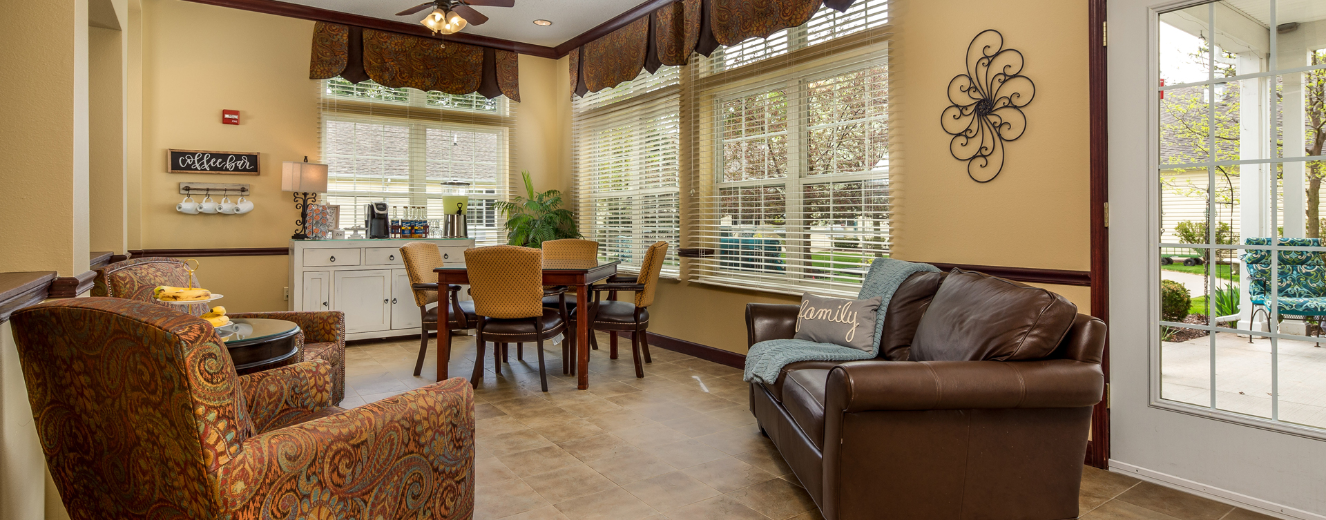Relax in the warmth of the sunroom at Bickford of Okemos