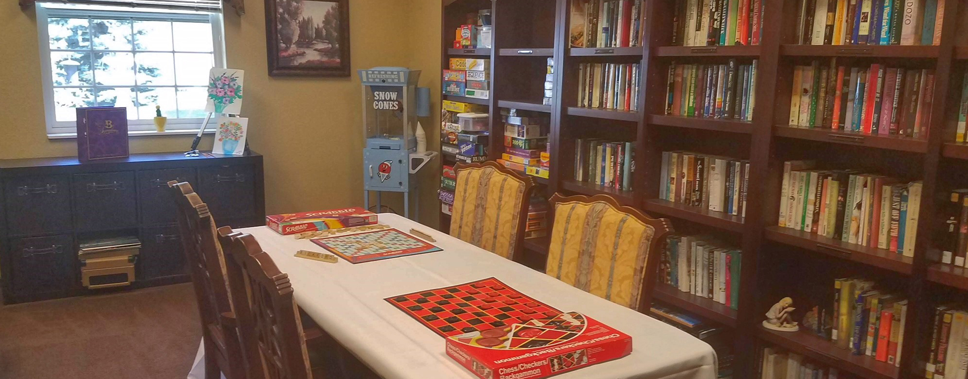 Enjoy a good card game with friends in the activity room at Bickford of Okemos