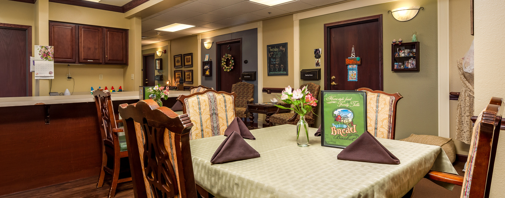 Residents with dementia receive additional assistance with meals in our Mary B's dining room at Bickford of Okemos