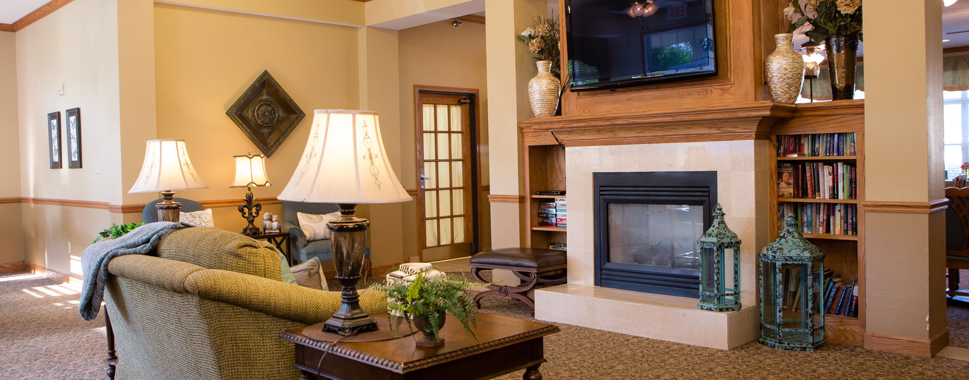 Enjoy a good book in the living room at Bickford of Macomb