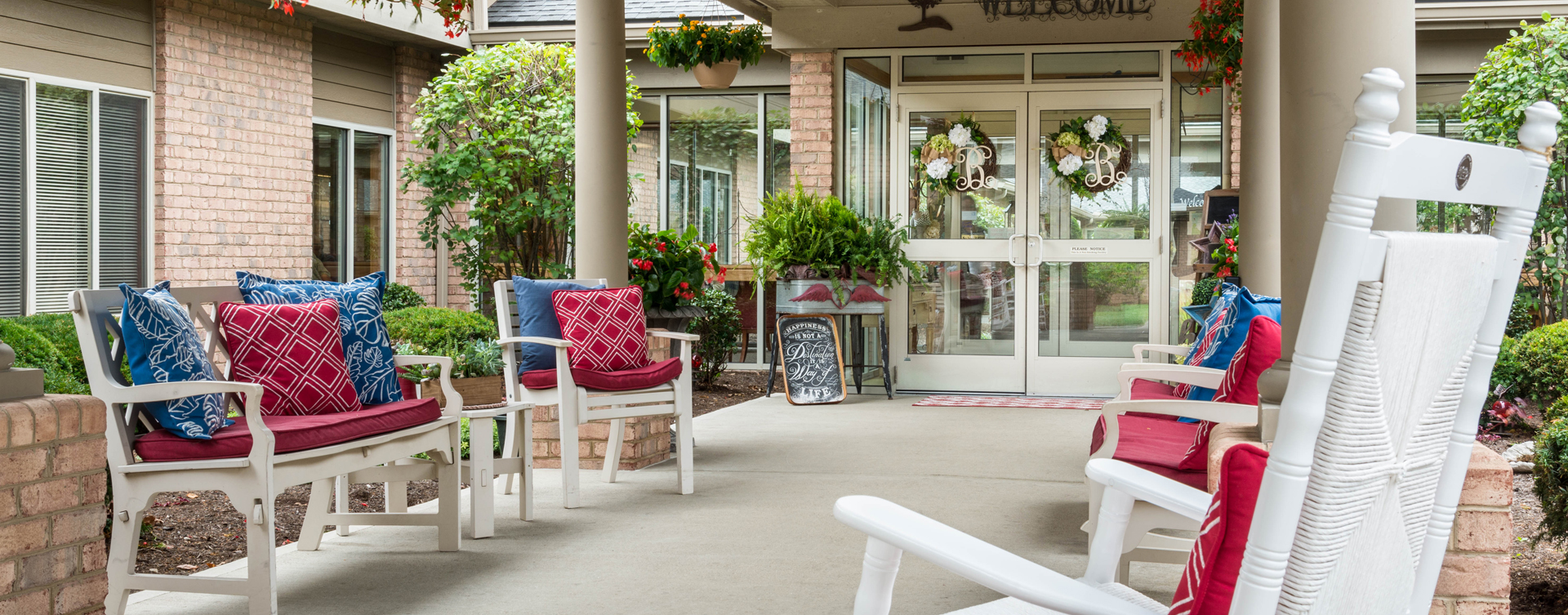 Enjoy conversations with friends on the porch at Bickford of Middletown
