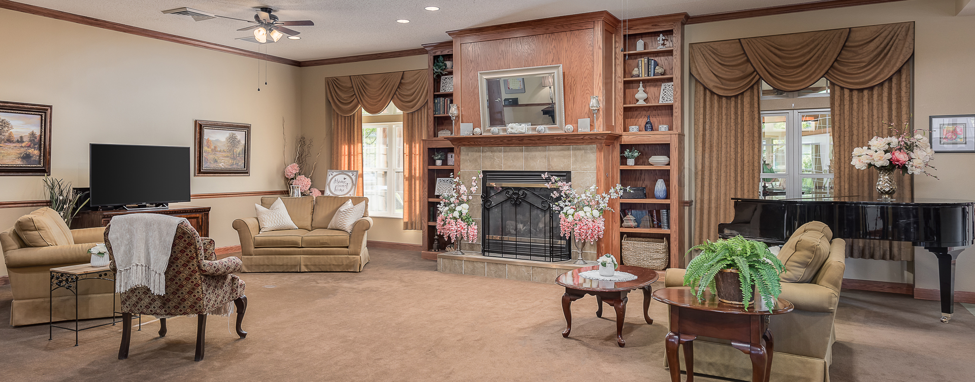 Enjoy a good book in the living room at Bickford of Midland