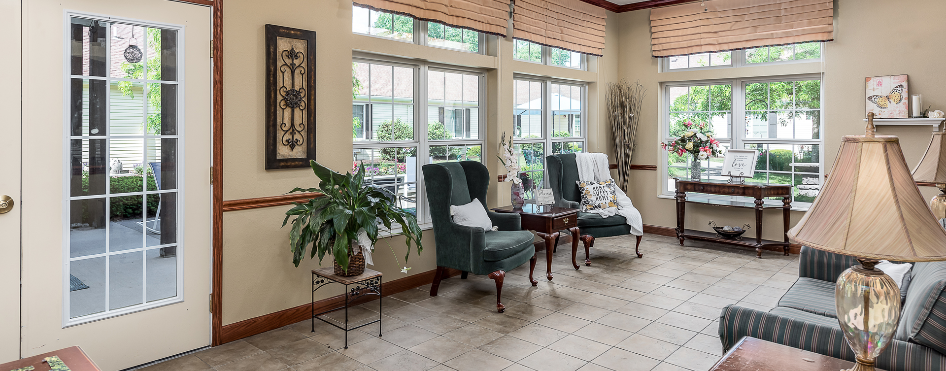 Curl up with a good book in the sunroom at Bickford of Midland
