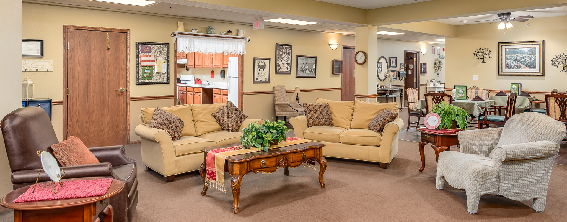 Residents can enjoy furniture covered in cozy fabrics in the Mary B's living room at Bickford of Midland