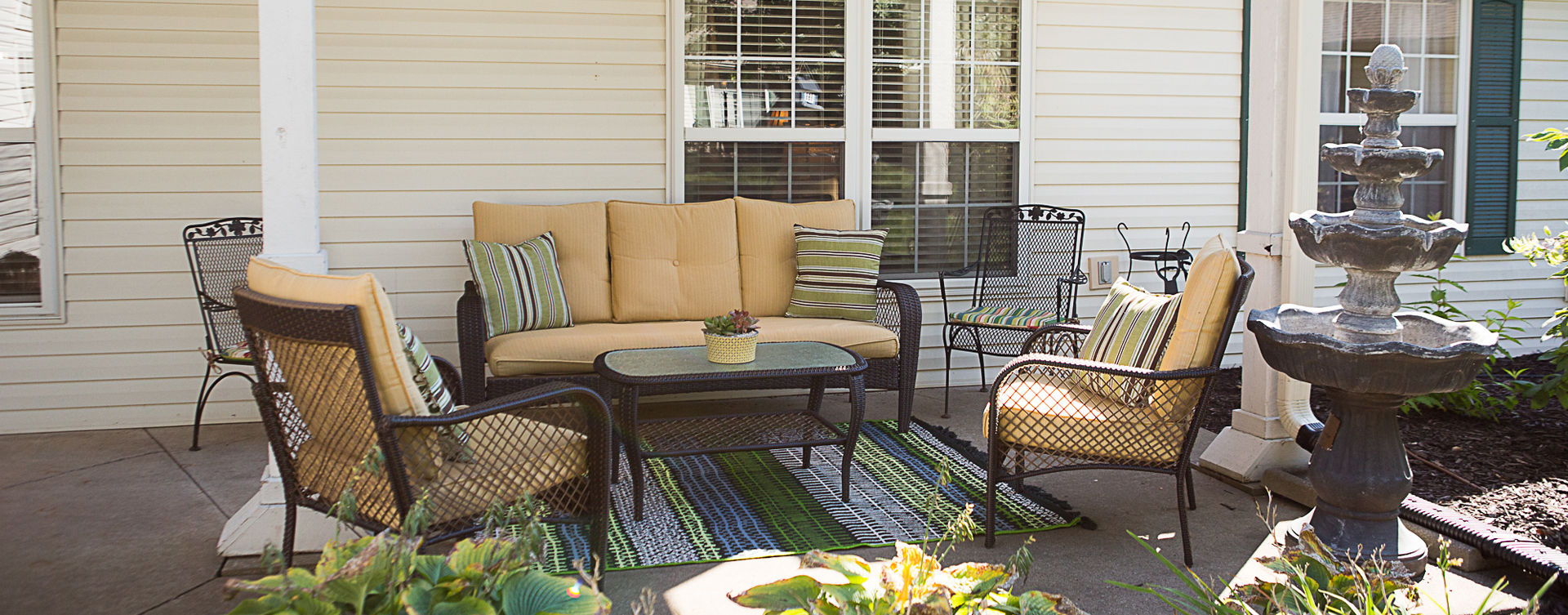 Sip on your favorite drink on the porch at Bickford of Muscatine