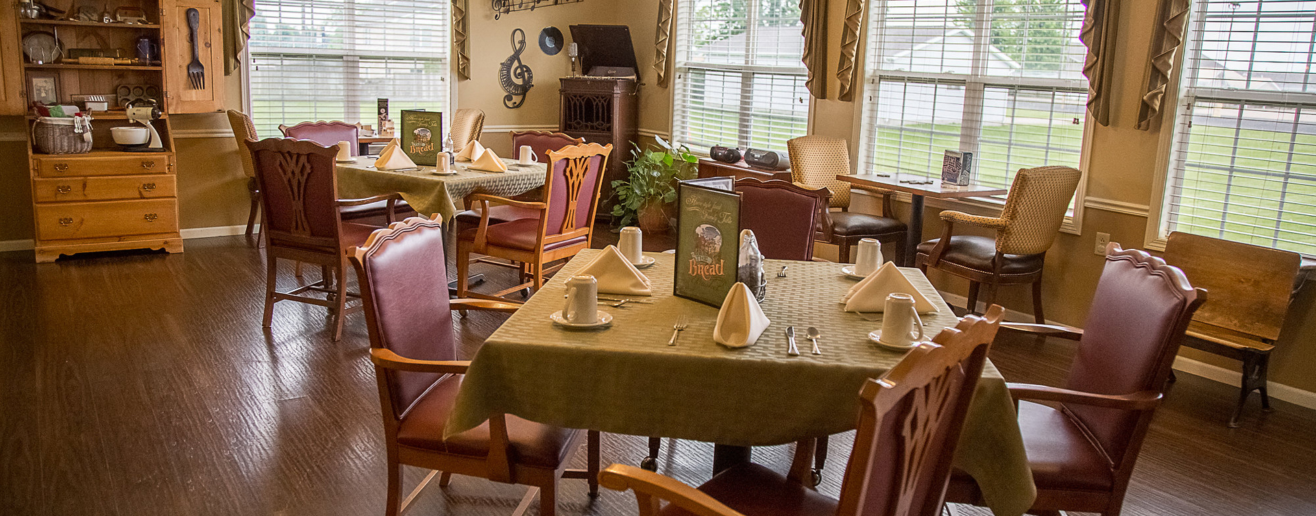 Residents with dementia receive additional assistance with meals in our Mary B's dining room at Bickford of Muscatine