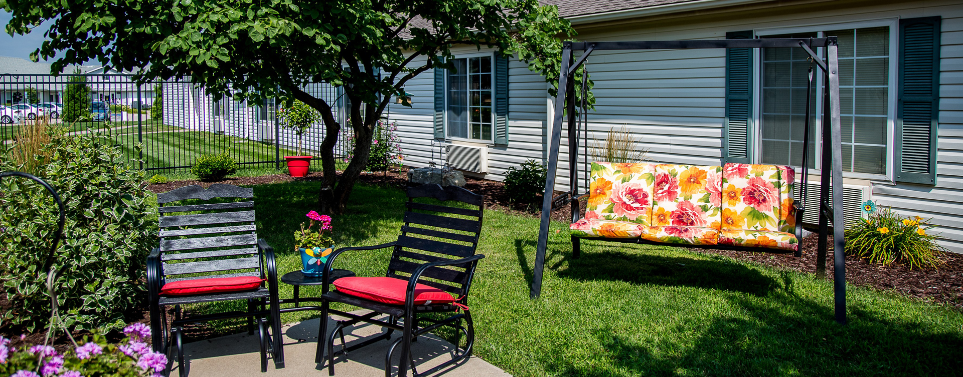 Residents with dementia can enjoy a traveling path, relaxed seating and raised garden beds in the courtyard at Bickford of Muscatine
