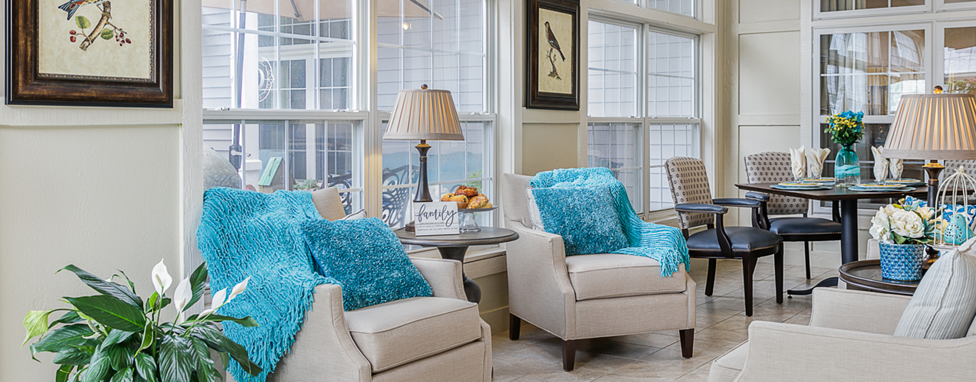 Curl up with a good book in the sunroom at Bickford of Omaha - Blondo