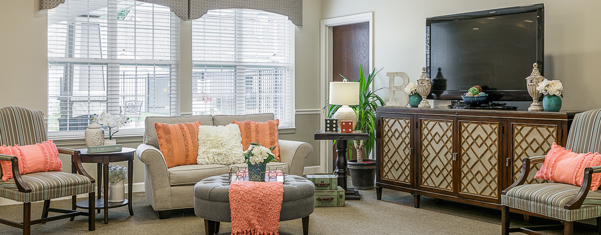 Residents can enjoy furniture covered in cozy fabrics in the Mary B's living room at Bickford of Omaha - Blondo